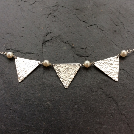 Bunting and pearls necklace