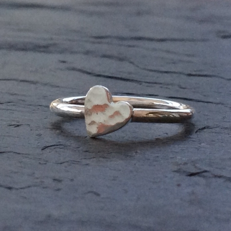 Tiny hammered silver heart ring
