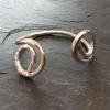 Spiral ended bracelet