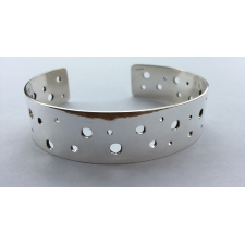Drilled cuff bracelet